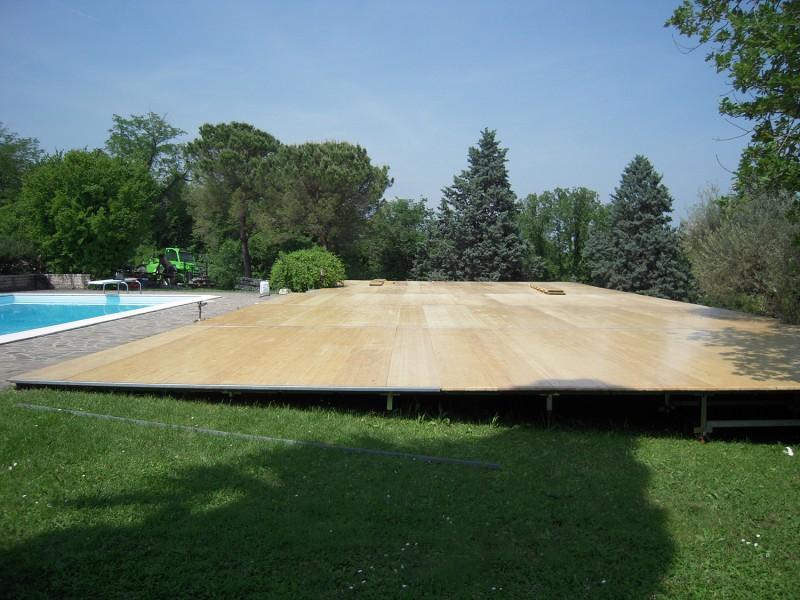 Noleggio piste da ballo pavimentazioni e piste in legno for Livellare terreno